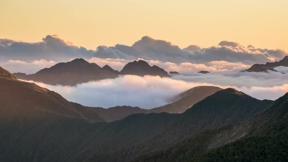 Thumbnail for Epic Evening with Clouds in Foggy Mountains Nature in New Zealand Wild Landscape Sunset