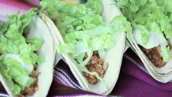 Thumbnail for Serving ground beef tacos on a corn tortillas.