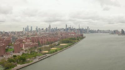 Flight Over Williamsburg Bridge Towards Empire State Building at Cloudy Day
