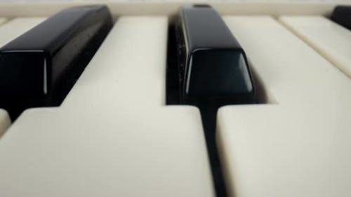 Panning Footage of Piano Keys