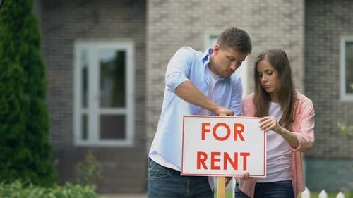 Couple Installing for Rent Signboard