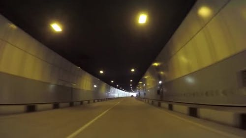 Car Driving Through The Tunnel From The Car Passenger Point Of View