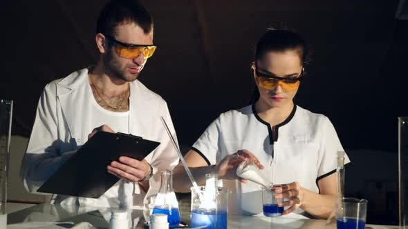 Thumbnail for Pair of Chemists are Conducting Experiments in Their Laboratory