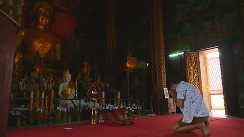 Man Is Respecting Buddha Statue