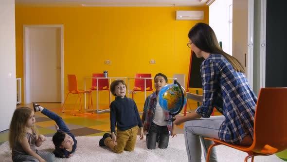 Thumbnail for Preschool Teacher Teaching Diverse Kids About Globe
