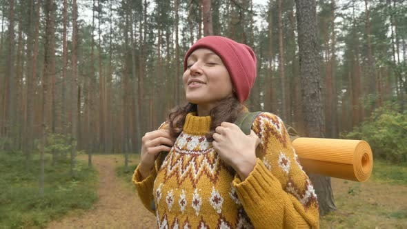 Thumbnail for Woman in Yellow Sweater Breathes Fresh Air in Pine Forest