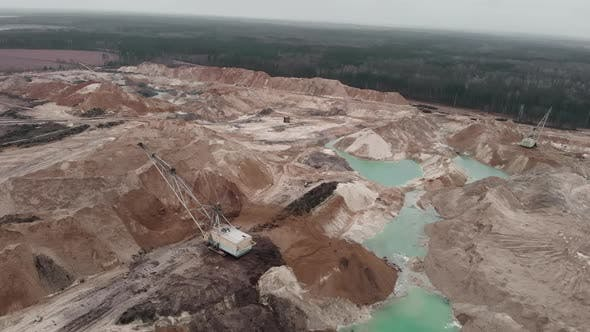 Thumbnail for Deep huge mining quarry with huge mounds of minerals. Sand extraction for construction industry