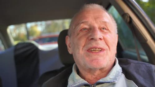 Close Up Portrait of Happy Caucasian Elderly 80s Man in Car, Active Relaxed Pension.