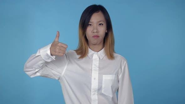 Thumbnail for Beautiful Korean Female Shows Sign Good Bad