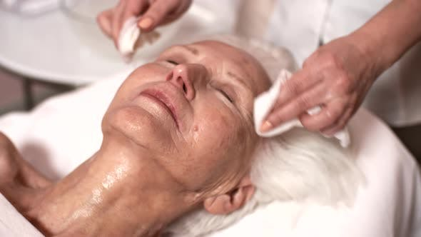 Thumbnail for Silver-Haired Caucasian Lady Enjoying Facial in Beauty Salon