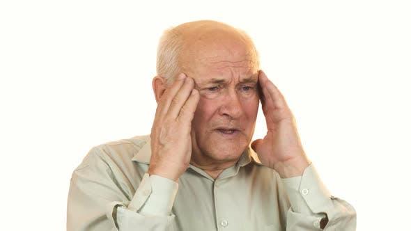 Thumbnail for Senior Man Having a Headache Rubbing His Temples