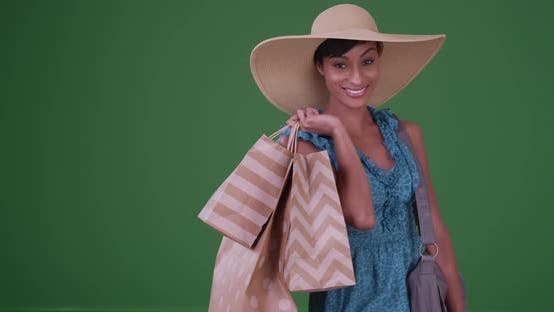 Thumbnail for Happy black woman shopping on green screen