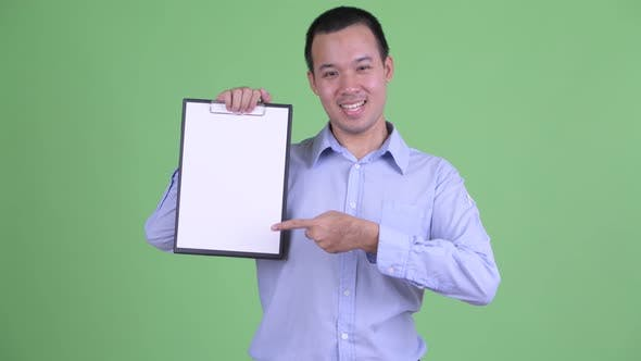 Thumbnail for Happy Asian Businessman Showing Clipboard and Giving Thumbs Up