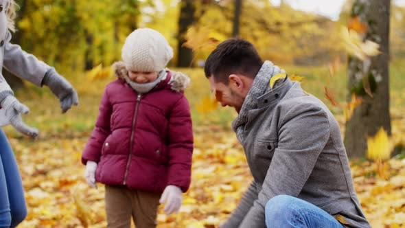 Cover Image for Happy Family Throwing Autumn Leaves at Park