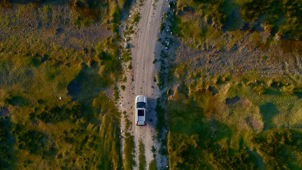 Cover Image for Aerial Car On Dirt Road