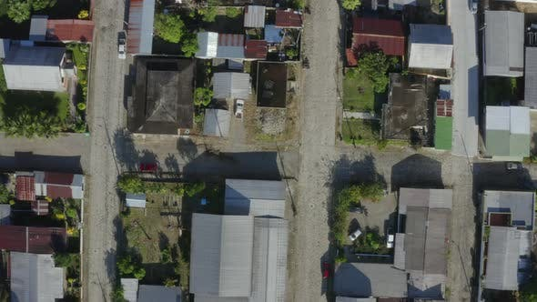 Top down aerial view of a street with small houses