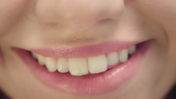 Thumbnail for Smiling Female Mouth with White Teeth