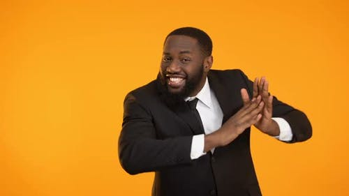 Cheerful African-American Man Dancing and Clutching Hands, Promo Campaign