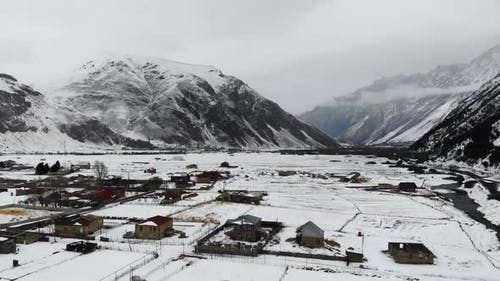 Drone Motion of Snowy Mountains Village