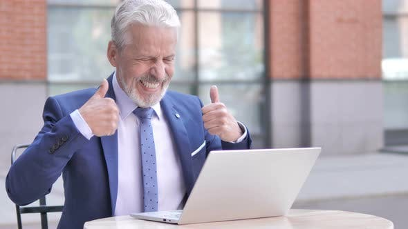 Thumbnail for Old Businessman Celebrating Success on Laptop Outdoor