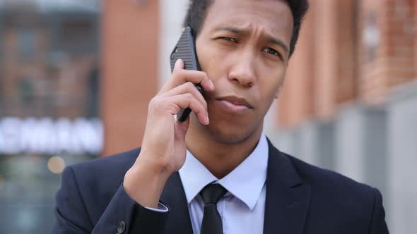 Thumbnail for African Businessman Talking on Phone, Discussing