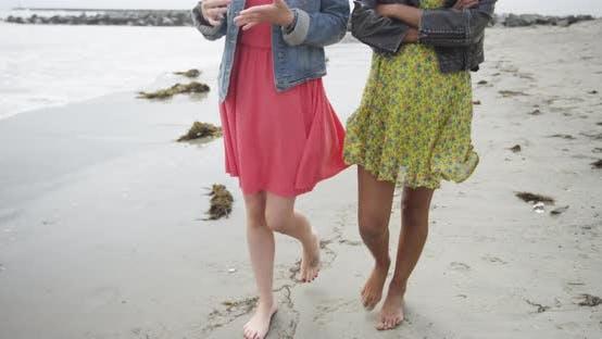 Thumbnail for Beautiful women walking along the beach together
