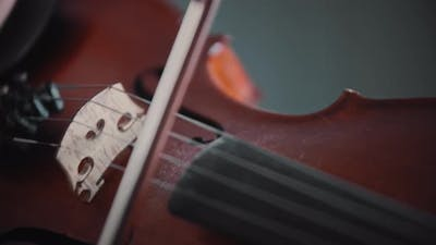 Young Woman Playing Violin  Playing with a Bow on the Strings