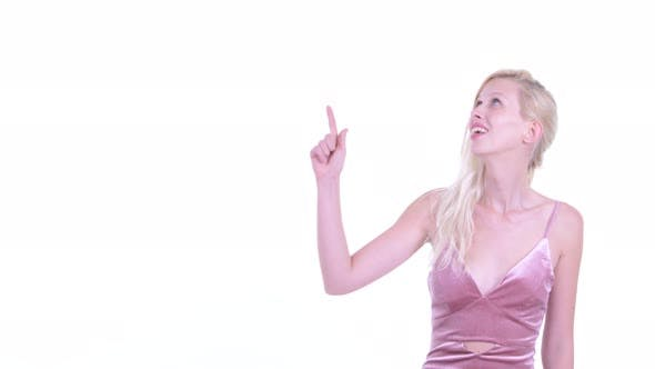 Thumbnail for Happy Young Beautiful Blonde Woman Thinking While Pointing Up
