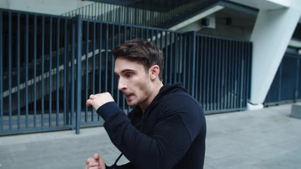 Thumbnail for Closeup Handsome Guy Practicing Beats Outdoor. Young Man Training Boxing Punch