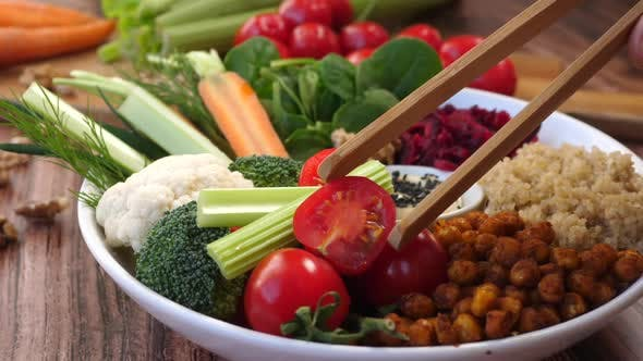 Thumbnail for Eating Healthy Salad With Quinoa, Chickpeas And Vegetable.