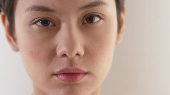 Thumbnail for Close up of serious asian woman's face
