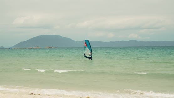 View of the City Beach and Active People Practicing Kite Surfing and Windsurfing