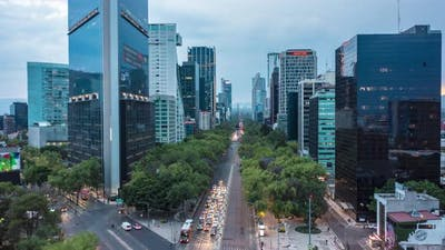 Aerial Hyperlapse Street View of Busy Urban Traffic on Multi Lane Road Urban Canyon Surrounded By