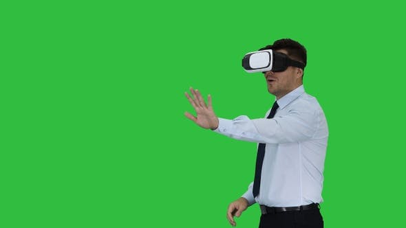 Cover Image for Businessman in virtual reality headset walking in virtual