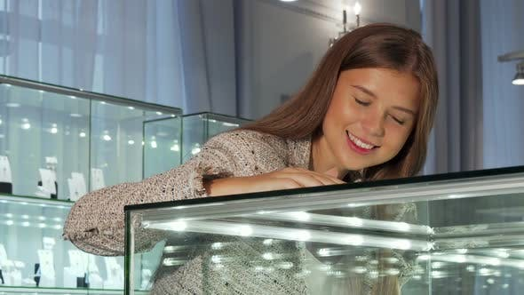 Thumbnail for Young Woman Looking in the Showcase at the Jewelry Store
