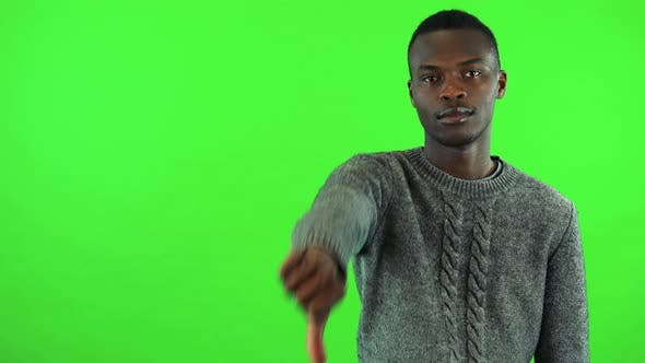 Thumbnail for A Young Black Man Shows a Thumb Down To the Camera - Green Screen Studio