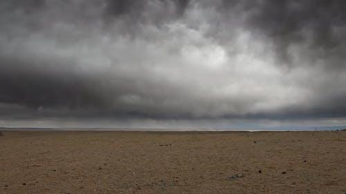 Dark Storm Clouds Over The Vast Arid Desert