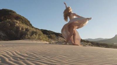 Dancer In Gold Dress On Beach