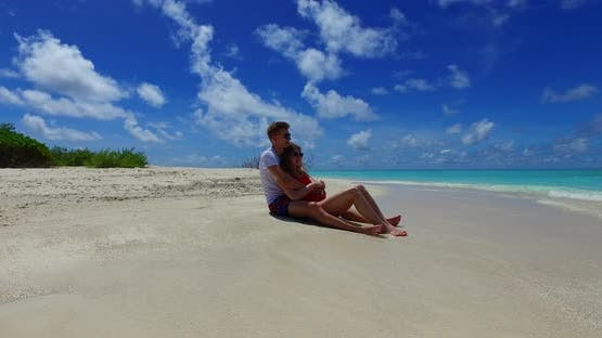 Happy lady and man in love dating on vacation spend quality time on beach on paradise white sand