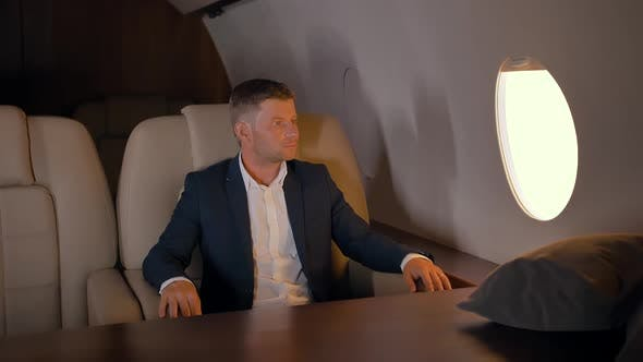 Thumbnail for Portrait of Businessman Sitting in Business Jet Armchair