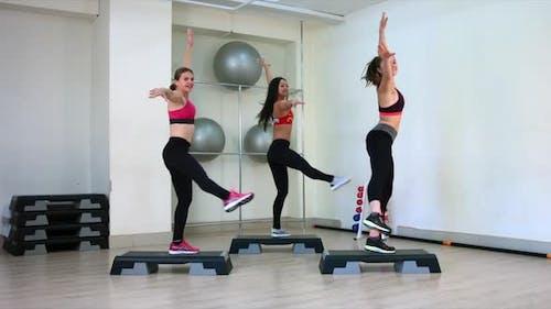Young Girls Perform Aerobics