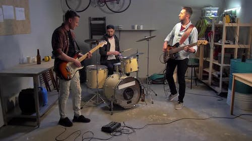Young Musicians in Garage Have a Repetitioon