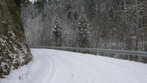 Snowy road with curves