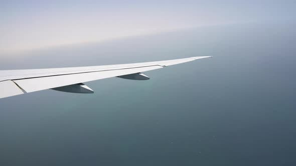 Thumbnail for View From the Window of the Aircraft on the Wing. Passenger Aircraft. the Plane Flies Over the Sea