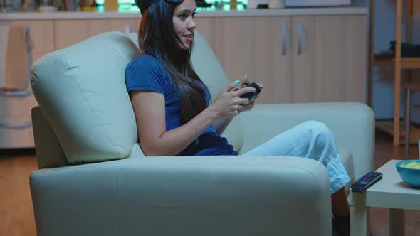 Woman Playing Video Games on Console