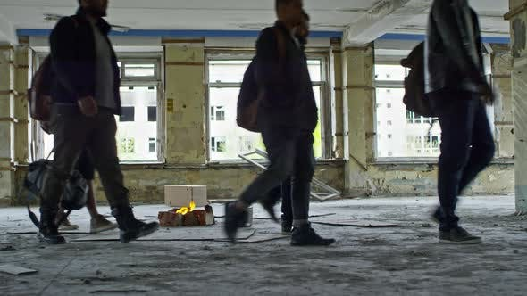 Thumbnail for Arab Refugees Walking in Abandoned Building