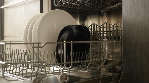 Thumbnail for Dish washing machine basket close-up 4K 2160p 30fps UltraHD footage - Dishware arranging inside buil
