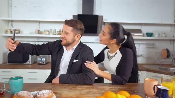Thumbnail for Couple Take Photos in the Kitchen