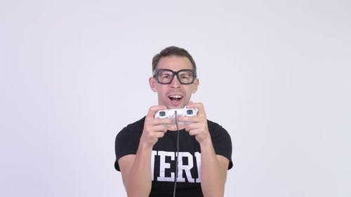 Studio Shot of Happy Nerd Man Playing Games