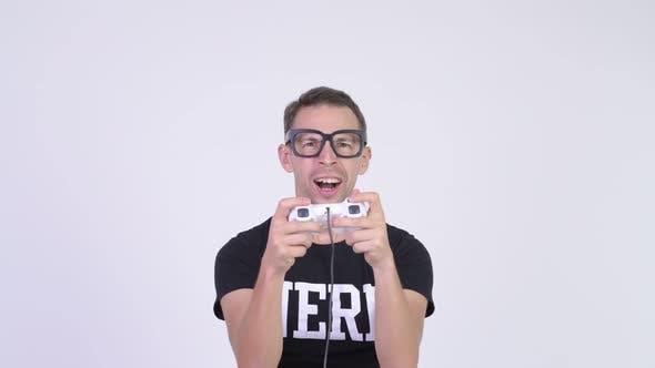Thumbnail for Studio Shot of Happy Nerd Man Playing Games